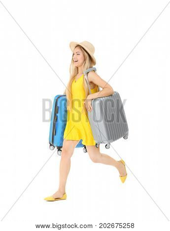 Young woman carrying luggage, on white background. Luggage overweight concept
