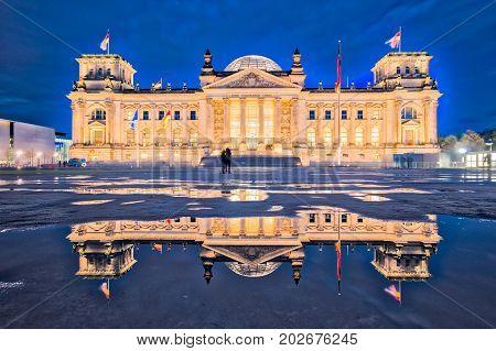 The Reichstag Building At Night In Berlin. (the Dedication Dem Deutschen Volke, Meaning To The Germa