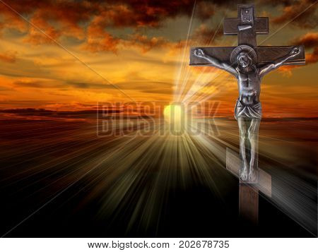 Silhouette of the crucified Jesus Christ on the cross against the red sky. The Biblical prophet is a symbol of death. Christmas Easter background.