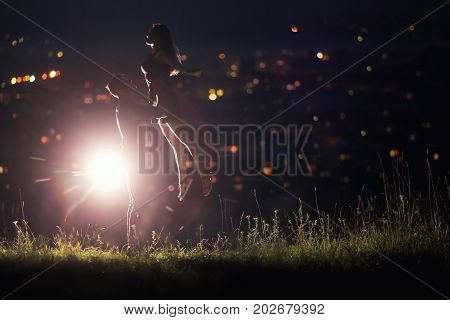 Close-up of loving couple dancing against background of night sky with stars, in  background night city - bokeh blurred. Concept first love, kiss, dance night, love without boundaries. copyspase