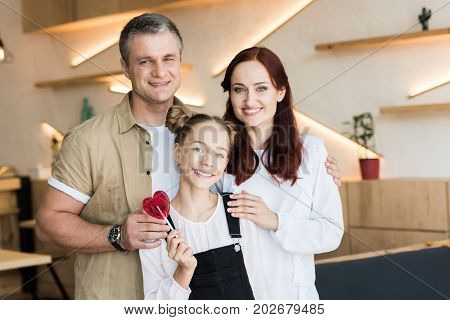 Couple And Teen Daughter In Cafe