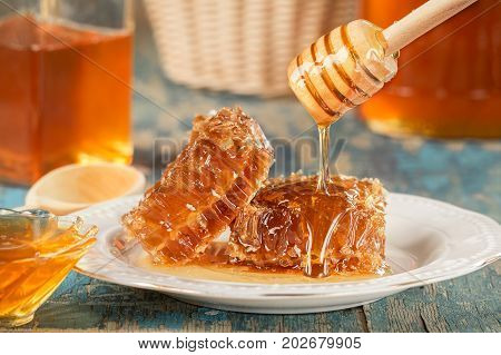 Sweet Honeycomb And Wooden Honey Dripping