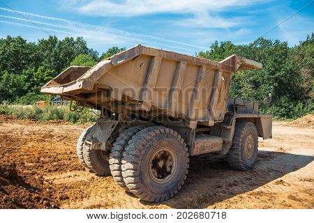 Big yellow mining truck, view from back