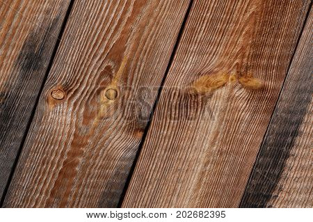 Wodden diagonal planks texture with knots in