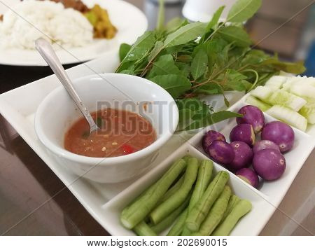Chili paste shrimp paste vegetable on Texture background