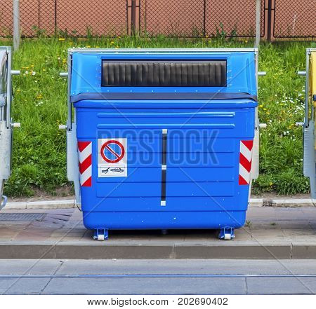 Blue recycling container on the street close