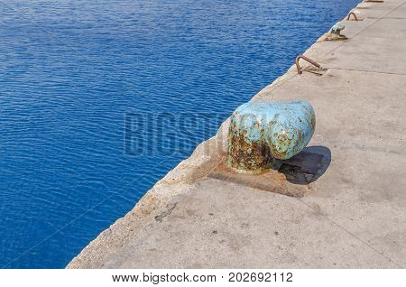 Bollard on the pierwith sea background CLOSE