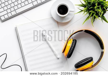 Desk of musician for songwriter work set with headphones on white background top view mockup