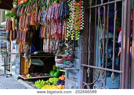 A street stall with typical Georgian candy - Churchkhela and Georgian spices. Tbilisi, Georgia