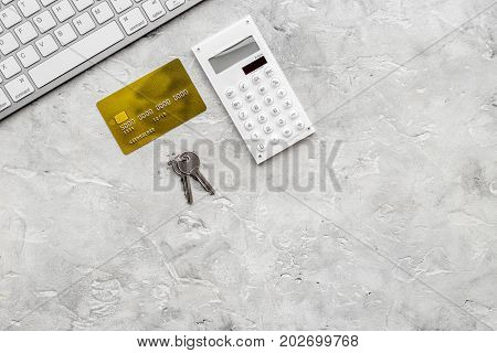 purchasing house set with online credit card payment on work desk stone background top view mock up