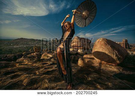 Portrait of freak woman against sky