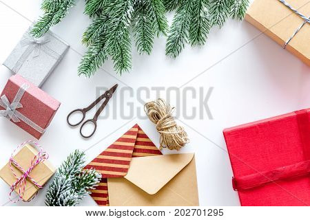 gifts wrapping set with envelopes for new year and christmas 2018 greeting on white table background top veiw