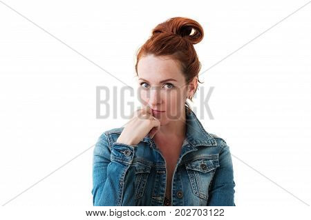 Portrait of young tender redhead woman with healthy freckled skin wearing jean jacket looking at camera with seriousemotion. poster