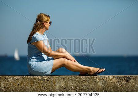 Woman resting on boulevard