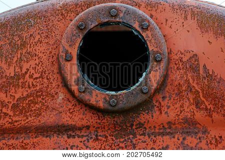 Close Up Background Of Rusty Metal Tank With Rusty Circular Hole