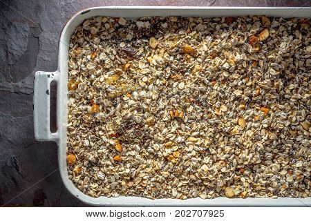 Granola mix in baking dish close-up horizontal