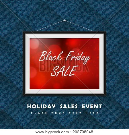 Black Friday Sale label in photo frame hanged on the textile clothes wall