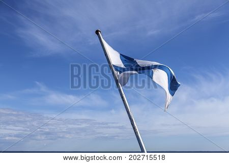 Finland, Finnish Standard. Top of a ship. Strong wind, windswept.