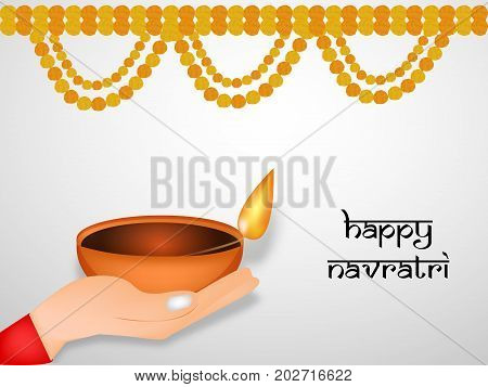 illustration of hand holding lamp and decoration with Happy Navratri text on the occasion of hindu festival Navratri