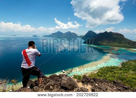 Unidentified Photographer On Top Of Bohey Dulang Island In Tun Sakaran Marine Park In The Vicinity O
