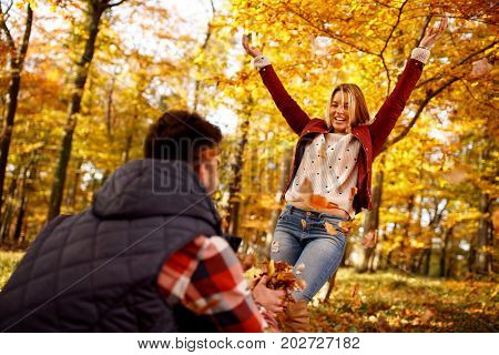 Love, lifestyle, romantic-young couple having fun in autumn park
