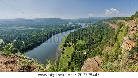 Aerial view of lowland of forest river a summer during a flight. Russia. Siberia