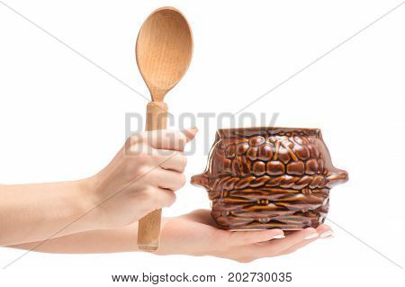 Jug for roast with a wooden spoon on a white background isolation