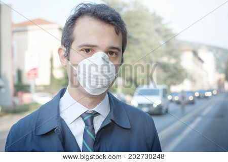 Man Walking In The City Wearing Protection Mask Against Smog Air Pollution