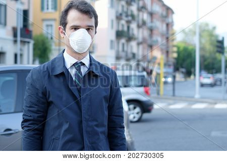 Man Walking In The City Wearing Protection Mask Against Smog Air