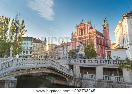 Romantic Ljubljana's city center: river Ljubljanica, Triple Bridge, Tromostovje, Preseren square and Franciscan Church of the Annunciation. Ljubljana, Slovenia, Europe.