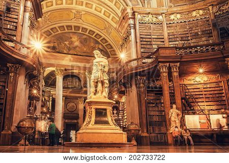 VIENNA, AUSTRIA - MAY 30, 2016: Interior of historical hall with sculptures and bookshelfs of Austrian National Library on May 30, 2016. Est in 18th century largest library in Austria with 7.4 mill items