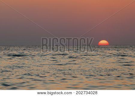 Multi colored sunset over tropical sea