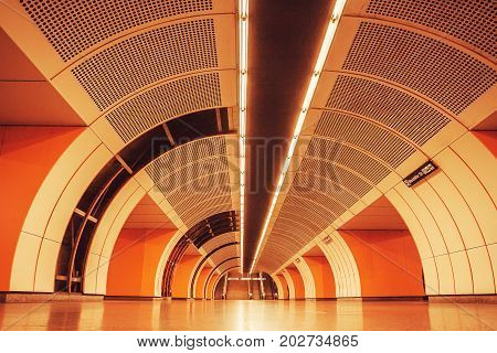 VIENNA - JUNE 1, 2016: Bright lights and archway inside metro station of Vienna U-Bahn on June 1, 2016 in Austria. More than 1.3 million passengers use the Vienna U-Bahn every day