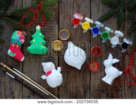 Painting Toys For Christmas Decorations From Porcelain With Your Own Hands. Children's Diy Concept.