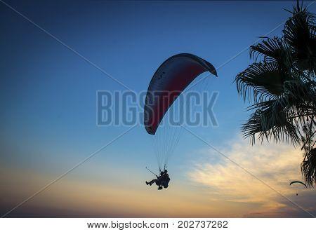 OLUDENIS, TURKEY - AUGUST 09, 2017: Paraglider tandem flying