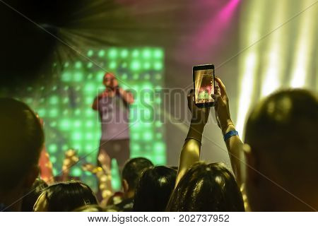Silhouette Of Hands With A Smartphone At A Concert