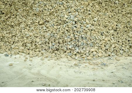 Pile of gravel stone on the street in the city road reconstruction site