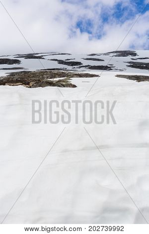 Snow and blue sky in Norway in summer