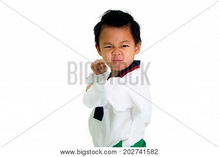 Asian boy wearing white Taekwondo suit acting ready to battle Isolated on white background.