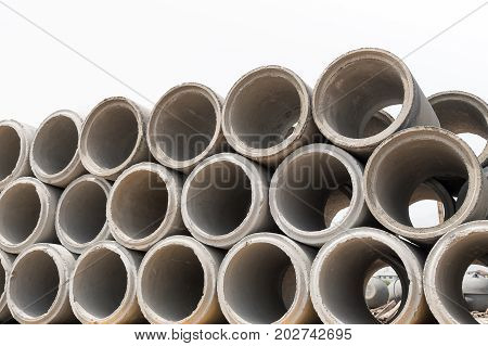 Concrete drainage pipes for industrial building construction.Isolated on white background.