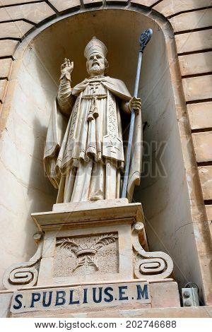 Statue of St Publius in an alcove on the front of the Parish church of our lady of sorrows Bugibba Malta Europe.