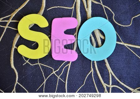 WORD SEO ON A  ABSTRACT  BLACK BACKGROUBND