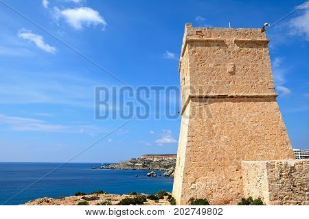 Ghajn Tuffieha watchtower overlooking the sea and cliffs Golden Bay Malta Europe.