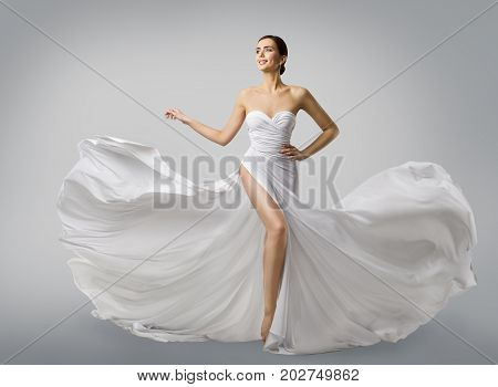 Woman White Dress Fashion Model Bride in Long Silk Wedding Gown Elegant Flying Fabric Fluttering Cloth