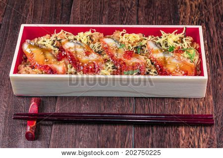Japanese Cuisine with rice japanese food on a grey wooden table wall background .