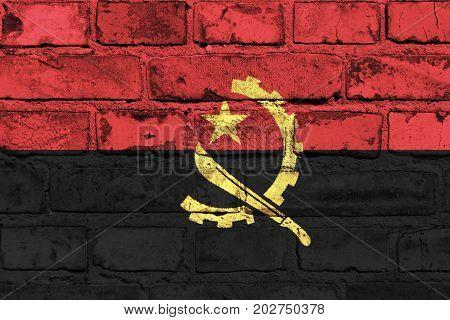 Angola flag painted on the brick wall