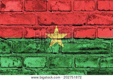 Burkina Faso flag painted on the brick wall