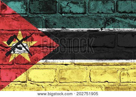 Mozambique flag painted on the brick wall