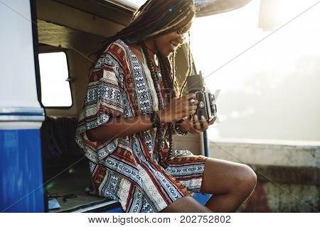 Woman Sitting with Camera Taking Snap Shoot Photo in a  Van