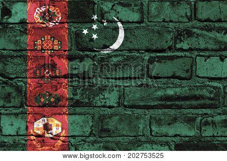 Turkmenistan flag painted on the brick wall